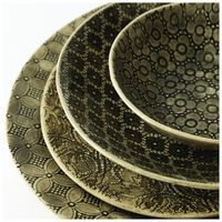 Wonki Ware 16-Piece Patterned Dinner Set -  black